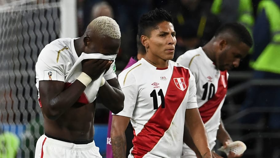 Peru's defender Luis Advincula (L) and his teammates forward Raul Ruidiaz and forward Jefferson Farfan react after the final whistle of the Russia 2018 World Cup Group C football match between France and Peru at the Ekaterinburg Arena in Ekaterinburg on June 21, 2018. (Photo by Anne-Christine POUJOULAT / AFP) / RESTRICTED TO EDITORIAL USE - NO MOBILE PUSH ALERTS/DOWNLOADS        (Photo credit should read ANNE-CHRISTINE POUJOULAT/AFP/Getty Images)
