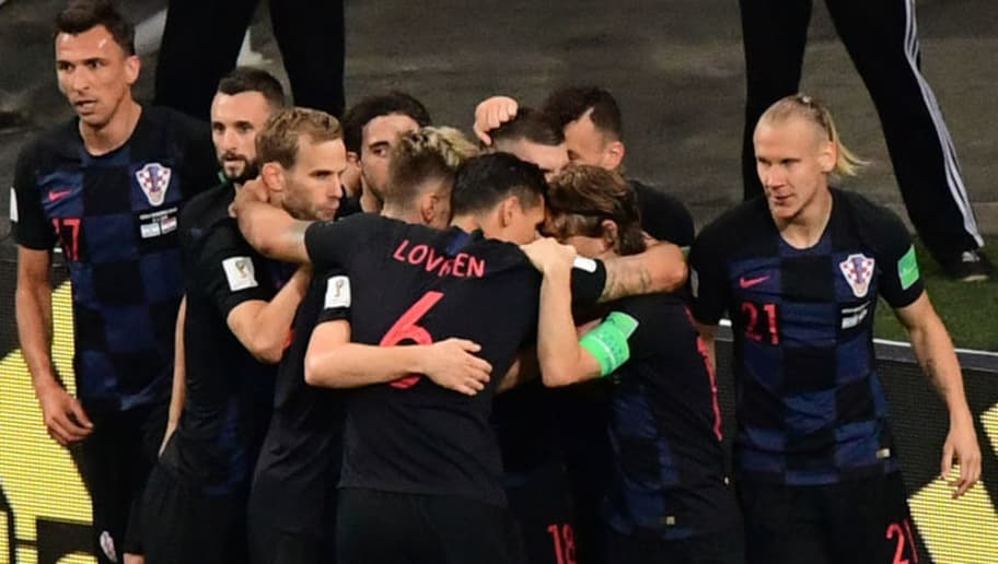 Croatia's forward Ante Rebic (hidden) celebrates with teammates after scoring during the Russia 2018 World Cup Group D football match between Argentina and Croatia at the Nizhny Novgorod Stadium in Nizhny Novgorod on June 21, 2018. (Photo by Martin BERNETTI / AFP) / RESTRICTED TO EDITORIAL USE - NO MOBILE PUSH ALERTS/DOWNLOADS        (Photo credit should read MARTIN BERNETTI/AFP/Getty Images)