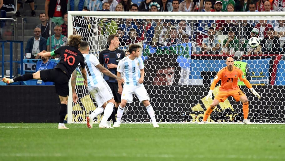 Croatia's midfielder Luka Modric (L) scores their second goal during the Russia 2018 World Cup Group D football match between Argentina and Croatia at the Nizhny Novgorod Stadium in Nizhny Novgorod on June 21, 2018. (Photo by Dimitar DILKOFF / AFP) / RESTRICTED TO EDITORIAL USE - NO MOBILE PUSH ALERTS/DOWNLOADS        (Photo credit should read DIMITAR DILKOFF/AFP/Getty Images)