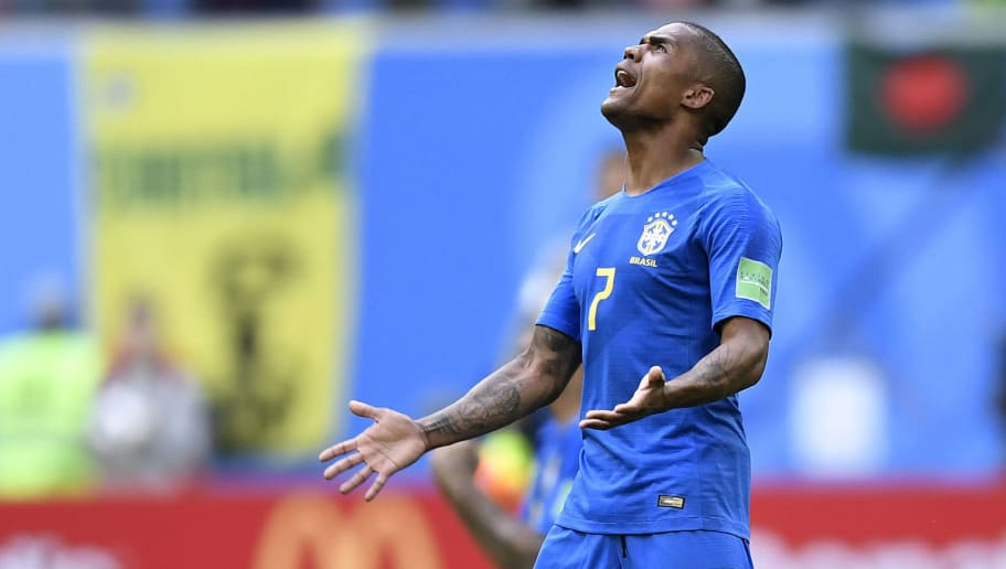 Brazil's forward Douglas Costa celebrates at the end of the Russia 2018 World Cup Group E football match between Brazil and Costa Rica at the Saint Petersburg Stadium in Saint Petersburg on June 22, 2018. (Photo by GABRIEL BOUYS / AFP) / RESTRICTED TO EDITORIAL USE - NO MOBILE PUSH ALERTS/DOWNLOADS        (Photo credit should read GABRIEL BOUYS/AFP/Getty Images)