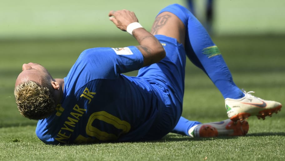 Brazil's forward Neymar lies on the ground after falling during the Russia 2018 World Cup Group E football match between Brazil and Costa Rica at the Saint Petersburg Stadium in Saint Petersburg on June 22, 2018. (Photo by GABRIEL BOUYS / AFP) / RESTRICTED TO EDITORIAL USE - NO MOBILE PUSH ALERTS/DOWNLOADS        (Photo credit should read GABRIEL BOUYS/AFP/Getty Images)