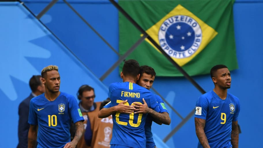 Brazil's forward Roberto Firmino (C-L) congratulates Brazil's forward Philippe Coutinho (C-R) for his goal during the Russia 2018 World Cup Group E football match between Brazil and Costa Rica at the Saint Petersburg Stadium in Saint Petersburg on June 22, 2018. (Photo by Paul ELLIS / AFP) / RESTRICTED TO EDITORIAL USE - NO MOBILE PUSH ALERTS/DOWNLOADS        (Photo credit should read PAUL ELLIS/AFP/Getty Images)