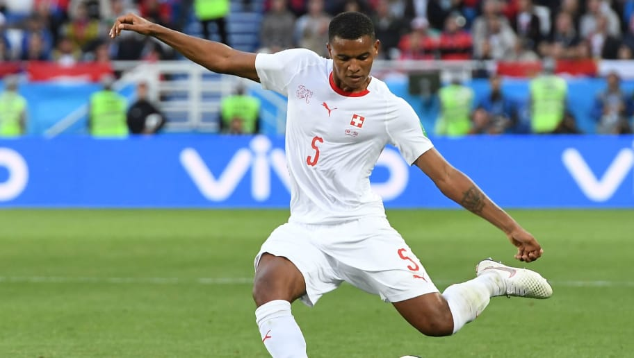 Switzerland's defender Manuel Akanji strikes the ball during their Russia 2018 World Cup Group E football match between Serbia and Switzerland at the Kaliningrad Stadium in Kaliningrad on June 22, 2018. (Photo by Attila KISBENEDEK / AFP) / RESTRICTED TO EDITORIAL USE - NO MOBILE PUSH ALERTS/DOWNLOADS        (Photo credit should read ATTILA KISBENEDEK/AFP/Getty Images)