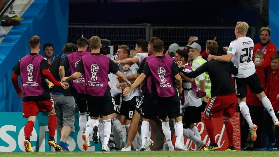 Germany's midfielder Toni Kroos (C) celebrates scoring the 2-1 goal with his teammates during the Russia 2018 World Cup Group F football match between Germany and Sweden at the Fisht Stadium in Sochi on June 23, 2018. (Photo by Adrian DENNIS / AFP) / RESTRICTED TO EDITORIAL USE - NO MOBILE PUSH ALERTS/DOWNLOADS        (Photo credit should read ADRIAN DENNIS/AFP/Getty Images)