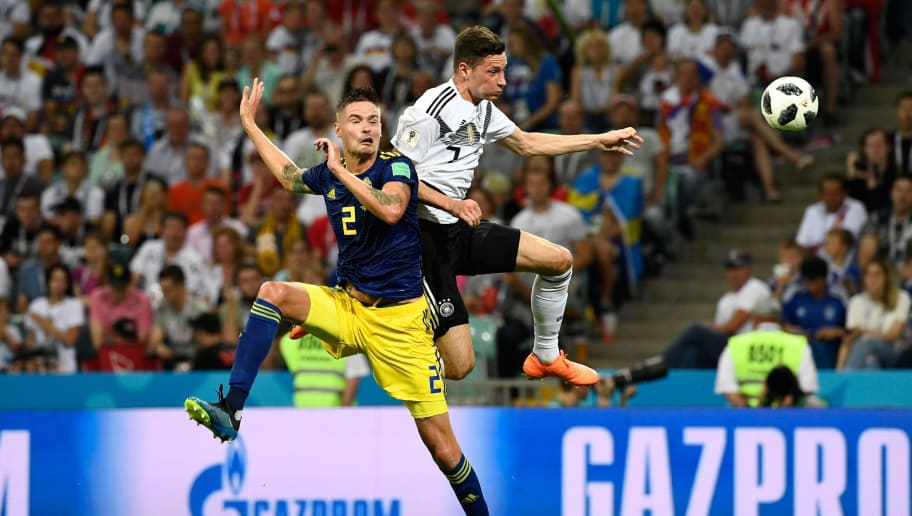 Sweden's defender Mikael Lustig (L) vies for the header with Germany's forward Julian Draxler during the Russia 2018 World Cup Group F football match between Germany and Sweden at the Fisht Stadium in Sochi on June 23, 2018. (Photo by Jonathan NACKSTRAND / AFP) / RESTRICTED TO EDITORIAL USE - NO MOBILE PUSH ALERTS/DOWNLOADS        (Photo credit should read JONATHAN NACKSTRAND/AFP/Getty Images)