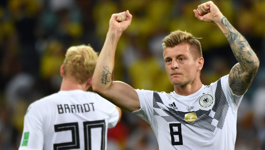 Germany's midfielder Toni Kroos celebrates scoring the 2-1 goal with his teammates during the Russia 2018 World Cup Group F football match between Germany and Sweden at the Fisht Stadium in Sochi on June 23, 2018. (Photo by Nelson Almeida / AFP) / RESTRICTED TO EDITORIAL USE - NO MOBILE PUSH ALERTS/DOWNLOADS        (Photo credit should read NELSON ALMEIDA/AFP/Getty Images)