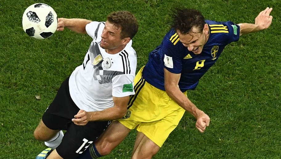 Sweden's midfielder Albin Ekdal (R) vies for the header with Germany's forward Thomas Mueller during the Russia 2018 World Cup Group F football match between Germany and Sweden at the Fisht Stadium in Sochi on June 23, 2018. (Photo by Jewel SAMAD / AFP) / RESTRICTED TO EDITORIAL USE - NO MOBILE PUSH ALERTS/DOWNLOADS        (Photo credit should read JEWEL SAMAD/AFP/Getty Images)