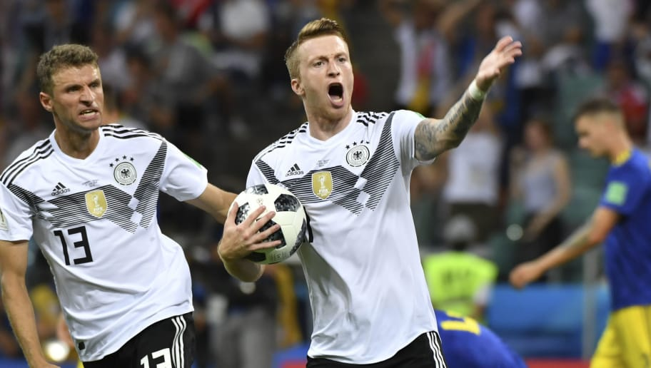 Germany's forward Marco Reus celebrates scoring the 1-1 goal with Germany's forward Thomas Mueller (L) during the Russia 2018 World Cup Group F football match between Germany and Sweden at the Fisht Stadium in Sochi on June 23, 2018. (Photo by Nelson Almeida / AFP) / RESTRICTED TO EDITORIAL USE - NO MOBILE PUSH ALERTS/DOWNLOADS        (Photo credit should read NELSON ALMEIDA/AFP/Getty Images)