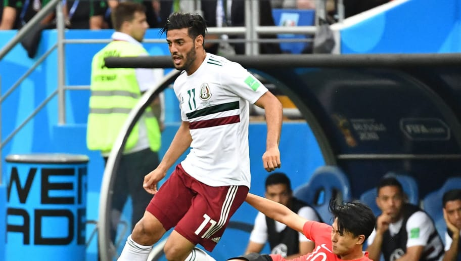 Mexico's forward Carlos Vela (L) vies with South Korea's midfielder Lee Seung-woo during the Russia 2018 World Cup Group F football match between South Korea and Mexico at the Rostov Arena in Rostov-On-Don on June 23, 2018. (Photo by JOE KLAMAR / AFP) / RESTRICTED TO EDITORIAL USE - NO MOBILE PUSH ALERTS/DOWNLOADS        (Photo credit should read JOE KLAMAR/AFP/Getty Images)