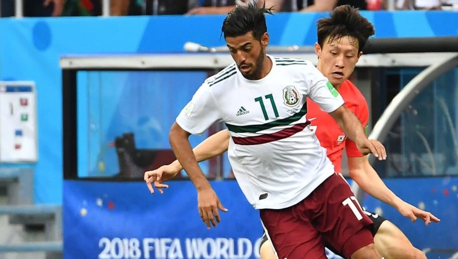 Mexico's forward Carlos Vela (L) controls the ball during the Russia 2018 World Cup Group F football match between South Korea and Mexico at the Rostov Arena in Rostov-On-Don on June 23, 2018. (Photo by JOE KLAMAR / AFP) / RESTRICTED TO EDITORIAL USE - NO MOBILE PUSH ALERTS/DOWNLOADS        (Photo credit should read JOE KLAMAR/AFP/Getty Images)