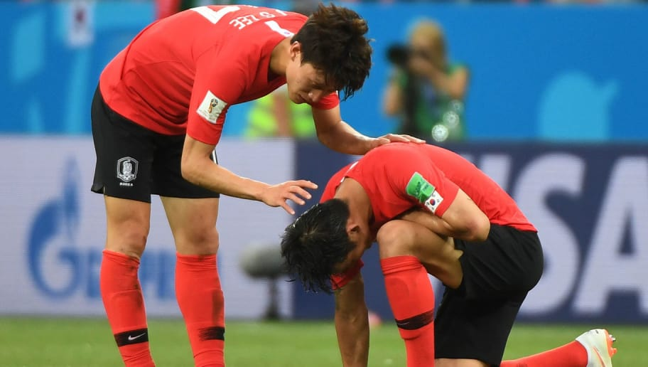 South Korea's defender Lee Yong (L) is comforted by South Korea's midfielder Lee Jae-sung (L) at the end of the Russia 2018 World Cup Group F football match between South Korea and Mexico at the Rostov Arena in Rostov-On-Don on June 23, 2018. (Photo by Khaled DESOUKI / AFP) / RESTRICTED TO EDITORIAL USE - NO MOBILE PUSH ALERTS/DOWNLOADS        (Photo credit should read KHALED DESOUKI/AFP/Getty Images)