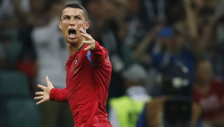 Portugal's forward Cristiano Ronaldo celebrates his third goal during the Russia 2018 World Cup Group B football match between Portugal and Spain at the Fisht Stadium in Sochi on June 15, 2018. (Photo by Odd ANDERSEN / AFP) / RESTRICTED TO EDITORIAL USE - NO MOBILE PUSH ALERTS/DOWNLOADS        (Photo credit should read ODD ANDERSEN/AFP/Getty Images)