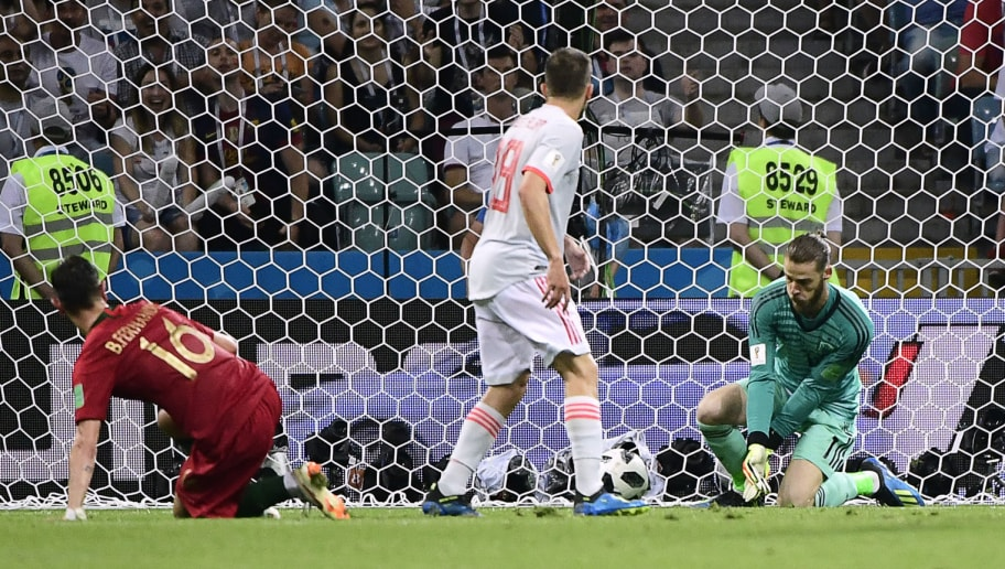 Spain's goalkeeper David De Gea (R) fails to block a second goal by Portugal's forward Cristiano Ronaldo (not in picture) during the Russia 2018 World Cup Group B football match between Portugal and Spain at the Fisht Stadium in Sochi on June 15, 2018. (Photo by PIERRE-PHILIPPE MARCOU / AFP) / RESTRICTED TO EDITORIAL USE - NO MOBILE PUSH ALERTS/DOWNLOADS        (Photo credit should read PIERRE-PHILIPPE MARCOU/AFP/Getty Images)