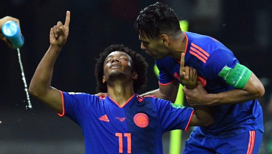 Colombia's forward Juan Cuadrado (L) celebrates with Colombia's forward Falcao after scoring their third goal during the Russia 2018 World Cup Group H football match between Poland and Colombia at the Kazan Arena in Kazan on June 24, 2018. (Photo by SAEED KHAN / AFP) / RESTRICTED TO EDITORIAL USE - NO MOBILE PUSH ALERTS/DOWNLOADS        (Photo credit should read SAEED KHAN/AFP/Getty Images)