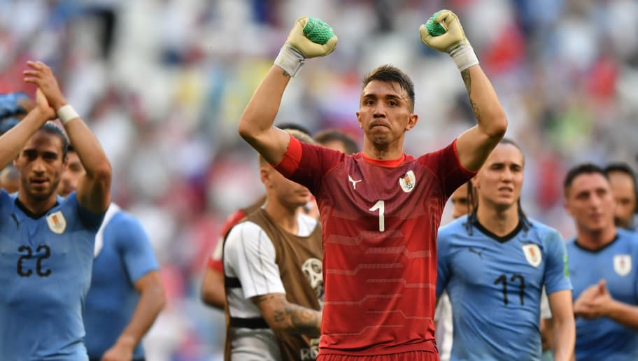 Uruguay's goalkeeper Fernando Muslera (front) celebrates with teammates at the end of the Russia 2018 World Cup Group A football match between Uruguay and Russia at the Samara Arena in Samara on June 25, 2018. (Photo by Fabrice COFFRINI / AFP) / RESTRICTED TO EDITORIAL USE - NO MOBILE PUSH ALERTS/DOWNLOADS        (Photo credit should read FABRICE COFFRINI/AFP/Getty Images)