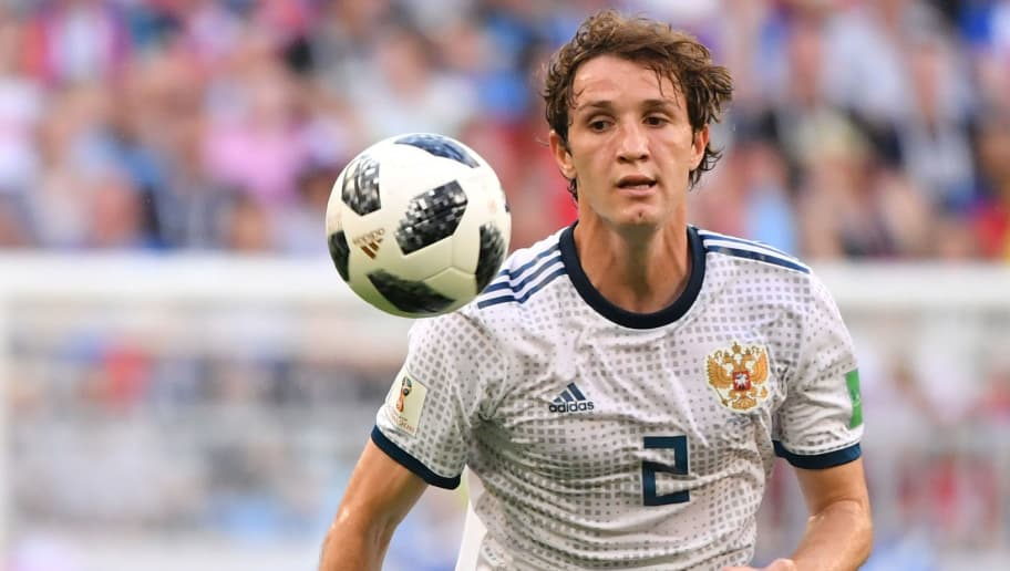 Russia's defender Mario Fernandes runs with the ball during the Russia 2018 World Cup Group A football match between Uruguay and Russia at the Samara Arena in Samara on June 25, 2018. (Photo by EMMANUEL DUNAND / AFP) / RESTRICTED TO EDITORIAL USE - NO MOBILE PUSH ALERTS/DOWNLOADS        (Photo credit should read EMMANUEL DUNAND/AFP/Getty Images)