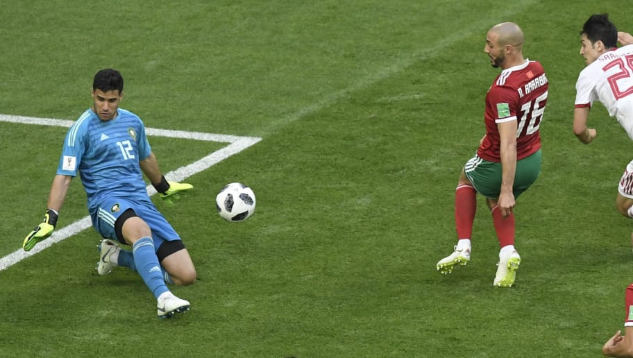 Morocco's goalkeeper Munir Mohand Mohamedi (L) blocks the ball  during the Russia 2018 World Cup Group B football match between Morocco and Iran at the Saint Petersburg Stadium in Saint Petersburg on June 15, 2018. (Photo by GABRIEL BOUYS / AFP) / RESTRICTED TO EDITORIAL USE - NO MOBILE PUSH ALERTS/DOWNLOADS        (Photo credit should read GABRIEL BOUYS/AFP/Getty Images)