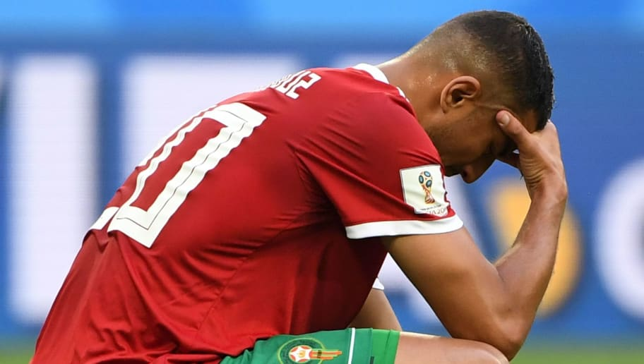 Morocco's forward Aziz Bouhaddouz reacts after he headed in the own goal during the Russia 2018 World Cup Group B football match between Morocco and Iran at the Saint Petersburg Stadium in Saint Petersburg on June 15, 2018. (Photo by Paul ELLIS / AFP) / RESTRICTED TO EDITORIAL USE - NO MOBILE PUSH ALERTS/DOWNLOADS        (Photo credit should read PAUL ELLIS/AFP/Getty Images)