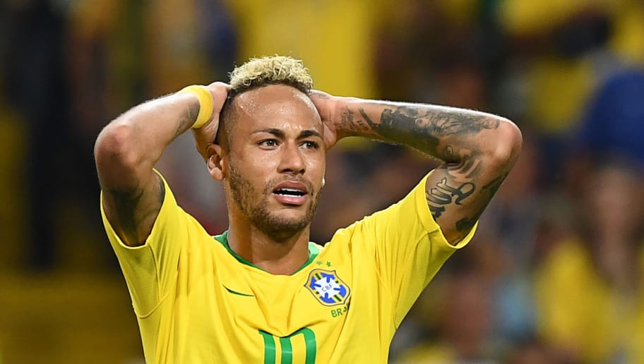 Brazil's forward Neymar reacts to a miss during the Russia 2018 World Cup Group E football match between Serbia and Brazil at the Spartak Stadium in Moscow on June 27, 2018. (Photo by Kirill KUDRYAVTSEV / AFP) / RESTRICTED TO EDITORIAL USE - NO MOBILE PUSH ALERTS/DOWNLOADS        (Photo credit should read KIRILL KUDRYAVTSEV/AFP/Getty Images)