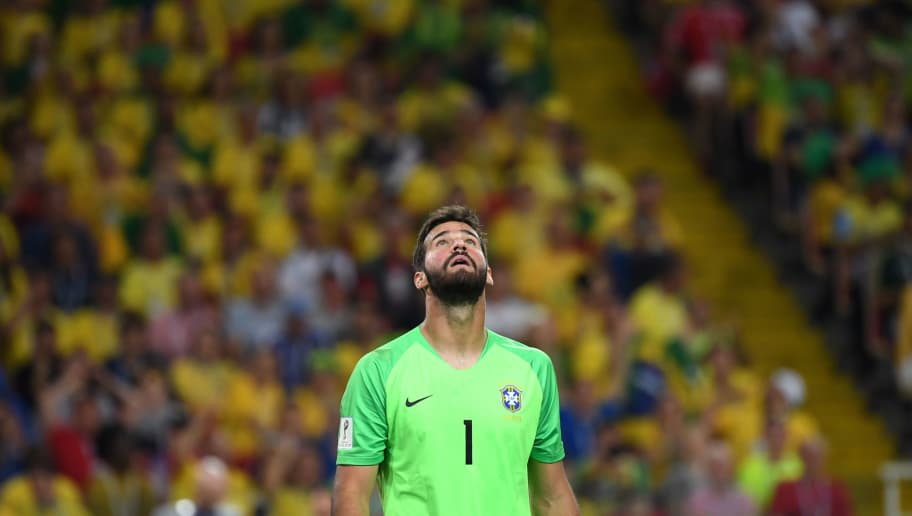 Brazil's goalkeeper Alisson looks up during the Russia 2018 World Cup Group E football match between Serbia and Brazil at the Spartak Stadium in Moscow on June 27, 2018. (Photo by Kirill KUDRYAVTSEV / AFP) / RESTRICTED TO EDITORIAL USE - NO MOBILE PUSH ALERTS/DOWNLOADS        (Photo credit should read KIRILL KUDRYAVTSEV/AFP/Getty Images)