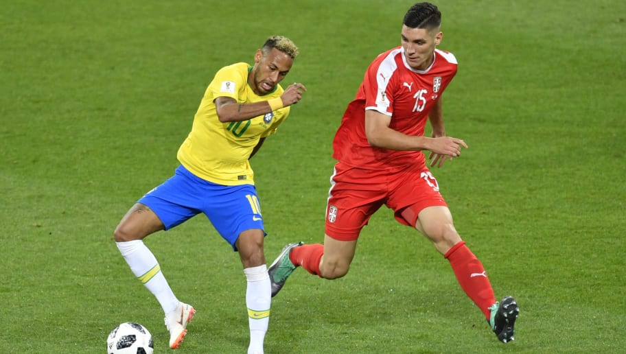 Brazil's forward Neymar (L) challenges Serbia's defender Nikola Milenkovic during the Russia 2018 World Cup Group E football match between Serbia and Brazil at the Spartak Stadium in Moscow on June 27, 2018. (Photo by Alexander NEMENOV / AFP) / RESTRICTED TO EDITORIAL USE - NO MOBILE PUSH ALERTS/DOWNLOADS        (Photo credit should read ALEXANDER NEMENOV/AFP/Getty Images)