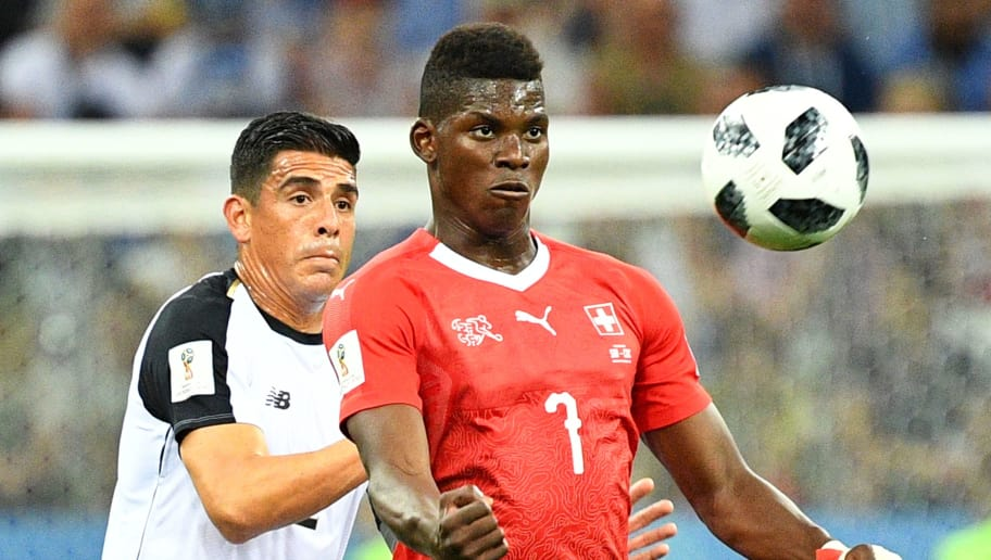 Costa Rica's defender Johnny Acosta (L) vies for the ball with Switzerland's forward Breel Embolo during the Russia 2018 World Cup Group E football match between Switzerland and Costa Rica at the Nizhny Novgorod Stadium in Nizhny Novgorod on June 27, 2018. (Photo by Johannes EISELE / AFP) / RESTRICTED TO EDITORIAL USE - NO MOBILE PUSH ALERTS/DOWNLOADS        (Photo credit should read JOHANNES EISELE/AFP/Getty Images)