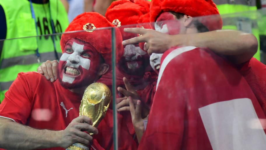 Switzerland supporters pose  during the Russia 2018 World Cup Group E football match between Switzerland and Costa Rica at the Nizhny Novgorod Stadium in Nizhny Novgorod on June 27, 2018. (Photo by Martin BERNETTI / AFP) / RESTRICTED TO EDITORIAL USE - NO MOBILE PUSH ALERTS/DOWNLOADS        (Photo credit should read MARTIN BERNETTI/AFP/Getty Images)