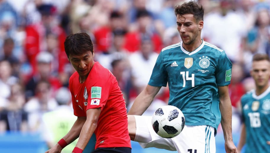 South Korea's midfielder Jung Woo-young (L) vies for the ball with Germany's midfielder Leon Goretzka during the Russia 2018 World Cup Group F football match between South Korea and Germany at the Kazan Arena in Kazan on June 27, 2018. (Photo by BENJAMIN CREMEL / AFP) / RESTRICTED TO EDITORIAL USE - NO MOBILE PUSH ALERTS/DOWNLOADS        (Photo credit should read BENJAMIN CREMEL/AFP/Getty Images)