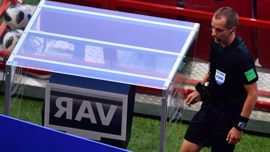 American referee Mark Geiger checks the VAR screen during the Russia 2018 World Cup Group F football match between South Korea and Germany at the Kazan Arena in Kazan on June 27, 2018. (Photo by Luis Acosta / AFP) / RESTRICTED TO EDITORIAL USE - NO MOBILE PUSH ALERTS/DOWNLOADS        (Photo credit should read LUIS ACOSTA/AFP/Getty Images)