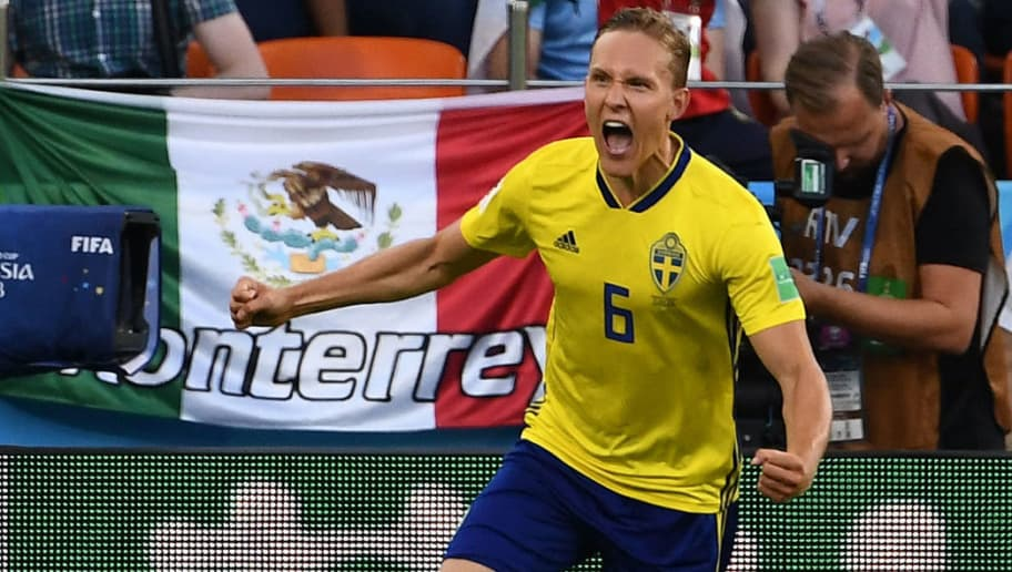 Sweden's defender Ludwig Augustinsson celebrates after scoring the opening goal during the Russia 2018 World Cup Group F football match between Mexico and Sweden at the Ekaterinburg Arena in Ekaterinburg on June 27, 2018. (Photo by Anne-Christine POUJOULAT / AFP) / RESTRICTED TO EDITORIAL USE - NO MOBILE PUSH ALERTS/DOWNLOADS        (Photo credit should read ANNE-CHRISTINE POUJOULAT/AFP/Getty Images)