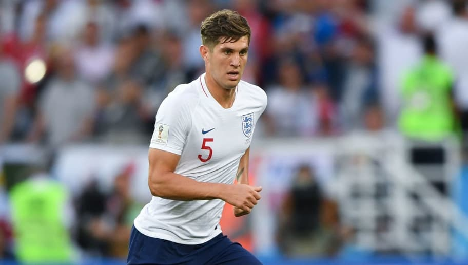 England's defender John Stones controls the ball during the Russia 2018 World Cup Group G football match between England and Belgium at the Kaliningrad Stadium in Kaliningrad on June 28, 2018. (Photo by OZAN KOSE / AFP) / RESTRICTED TO EDITORIAL USE - NO MOBILE PUSH ALERTS/DOWNLOADS        (Photo credit should read OZAN KOSE/AFP/Getty Images)