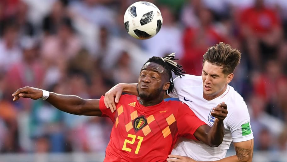 England's defender John Stones vies with Belgium's forward Michy Batshuayi (L) during the Russia 2018 World Cup Group G football match between England and Belgium at the Kaliningrad Stadium in Kaliningrad on June 28, 2018. (Photo by OZAN KOSE / AFP) / RESTRICTED TO EDITORIAL USE - NO MOBILE PUSH ALERTS/DOWNLOADS        (Photo credit should read OZAN KOSE/AFP/Getty Images)