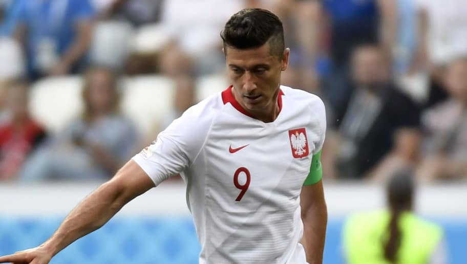 Poland's forward Robert Lewandowski controls the ball during the Russia 2018 World Cup Group H football match between Japan and Poland at the Volgograd Arena in Volgograd on June 28, 2018. (Photo by Philippe DESMAZES / AFP) / RESTRICTED TO EDITORIAL USE - NO MOBILE PUSH ALERTS/DOWNLOADS        (Photo credit should read PHILIPPE DESMAZES/AFP/Getty Images)