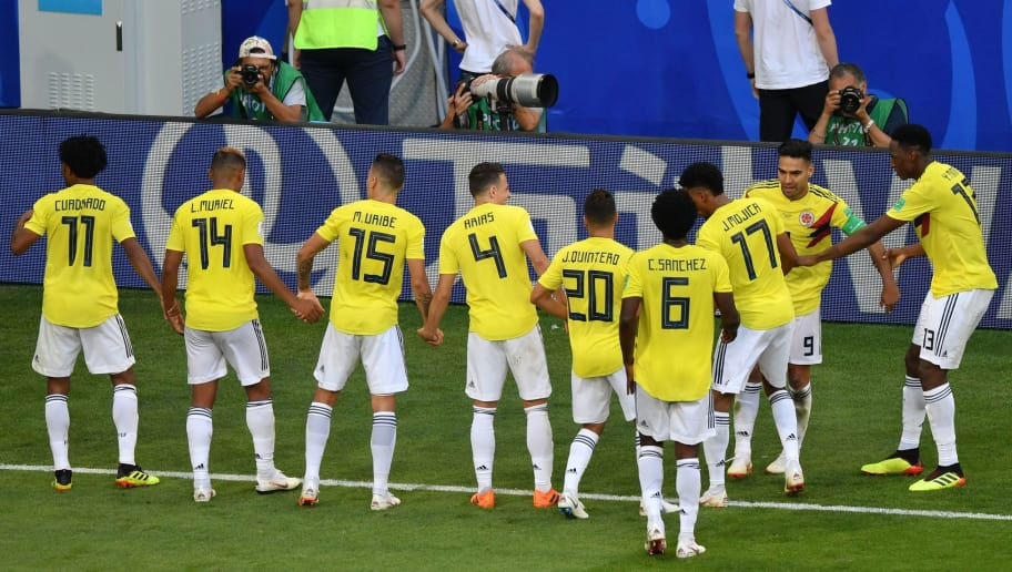 85120d236 Colombia s defender Yerry Mina (R) celebrates with teammates after scoring  a goal during the