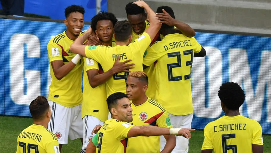 5ba10e4a6 Colombia s defender Yerry Mina (rear C) celebrates with teammates after  scoring a goal during