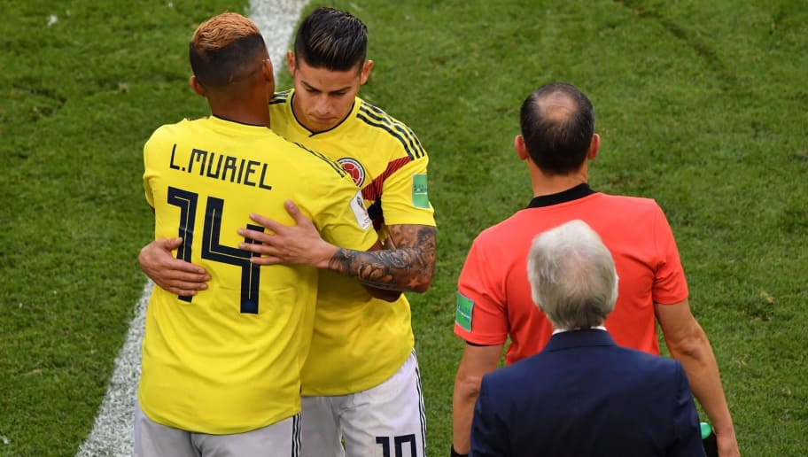 Colombia's midfielder James Rodriguez (rear C) is hugged by Colombia's forward Luis Muriel (C) as he leaves the football picth due to an injury during the Russia 2018 World Cup Group H football match between Senegal and Colombia at the Samara Arena in Samara on June 28, 2018. (Photo by Fabrice COFFRINI / AFP) / RESTRICTED TO EDITORIAL USE - NO MOBILE PUSH ALERTS/DOWNLOADS        (Photo credit should read FABRICE COFFRINI/AFP/Getty Images)