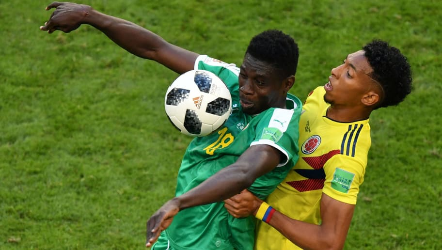Senegal's forward Ismaila Sarr (L) vies for the ball with Colombia's defender Johan Mojica during the Russia 2018 World Cup Group H football match between Senegal and Colombia at the Samara Arena in Samara on June 28, 2018. (Photo by Fabrice COFFRINI / AFP) / RESTRICTED TO EDITORIAL USE - NO MOBILE PUSH ALERTS/DOWNLOADS        (Photo credit should read FABRICE COFFRINI/AFP/Getty Images)