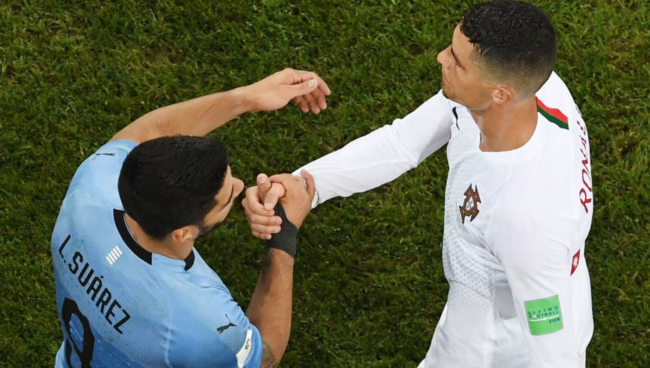 Uruguay's forward Luis Suarez (L) shakes hands with Portugal's forward Cristiano Ronaldo at the end of the Russia 2018 World Cup round of 16 football match between Uruguay and Portugal at the Fisht Stadium in Sochi on June 30, 2018. (Photo by Kirill KUDRYAVTSEV / AFP) / RESTRICTED TO EDITORIAL USE - NO MOBILE PUSH ALERTS/DOWNLOADS        (Photo credit should read KIRILL KUDRYAVTSEV/AFP/Getty Images)