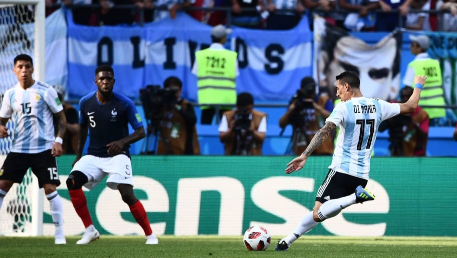 Argentina's forward Angel Di Maria (R) shoots to score the equaliser during the Russia 2018 World Cup round of 16 football match between France and Argentina at the Kazan Arena in Kazan on June 30, 2018. (Photo by Jewel SAMAD / AFP) / RESTRICTED TO EDITORIAL USE - NO MOBILE PUSH ALERTS/DOWNLOADS        (Photo credit should read JEWEL SAMAD/AFP/Getty Images)