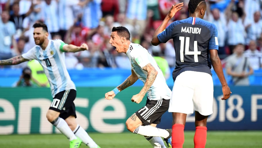Argentina's forward Angel Di Maria (C) celebrates past Argentina's forward Lionel Messi (L) after scoring their first goal during the Russia 2018 World Cup round of 16 football match between France and Argentina at the Kazan Arena in Kazan on June 30, 2018. (Photo by FRANCK FIFE / AFP) / RESTRICTED TO EDITORIAL USE - NO MOBILE PUSH ALERTS/DOWNLOADS        (Photo credit should read FRANCK FIFE/AFP/Getty Images)