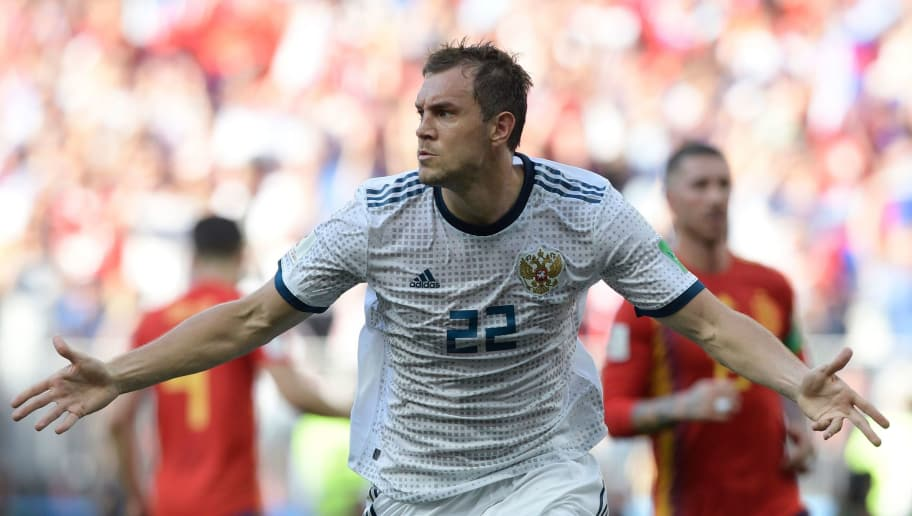 Russia's forward Artem Dzyuba celebrates after shooting a penalty kick and score a goal during the Russia 2018 World Cup round of 16 football match between Spain and Russia at the Luzhniki Stadium in Moscow on July 1, 2018. (Photo by Juan Mabromata / AFP) / RESTRICTED TO EDITORIAL USE - NO MOBILE PUSH ALERTS/DOWNLOADS        (Photo credit should read JUAN MABROMATA/AFP/Getty Images)