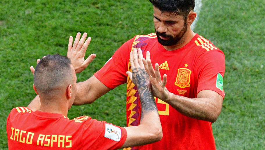Spain's forward Diego Costa (R) is replaced by Spain's forward Iago Aspas during the Russia 2018 World Cup round of 16 football match between Spain and Russia at the Luzhniki Stadium in Moscow on July 1, 2018. (Photo by Mladen ANTONOV / AFP) / RESTRICTED TO EDITORIAL USE - NO MOBILE PUSH ALERTS/DOWNLOADS        (Photo credit should read MLADEN ANTONOV/AFP/Getty Images)