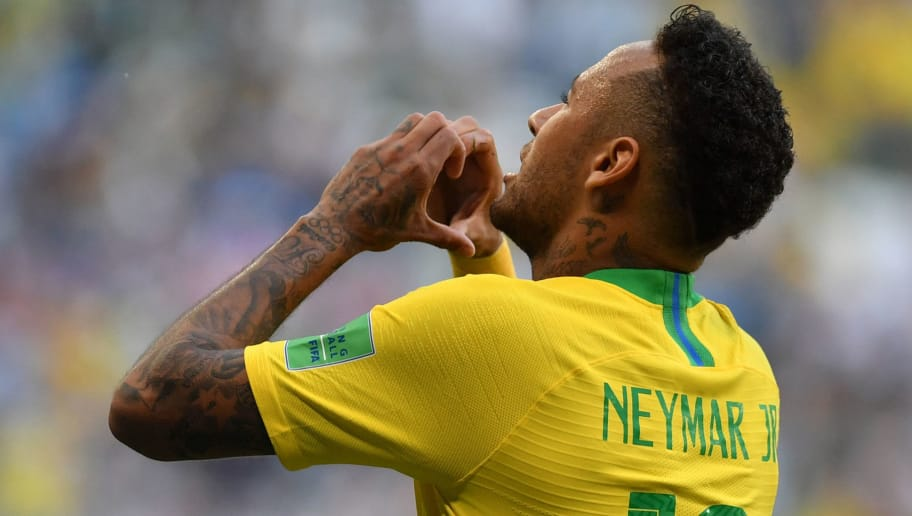 Brazil's forward Neymar celebrates after scoring the opening goal during the Russia 2018 World Cup round of 16 football match between Brazil and Mexico at the Samara Arena in Samara on July 2, 2018. (Photo by Fabrice COFFRINI / AFP) / RESTRICTED TO EDITORIAL USE - NO MOBILE PUSH ALERTS/DOWNLOADS        (Photo credit should read FABRICE COFFRINI/AFP/Getty Images)