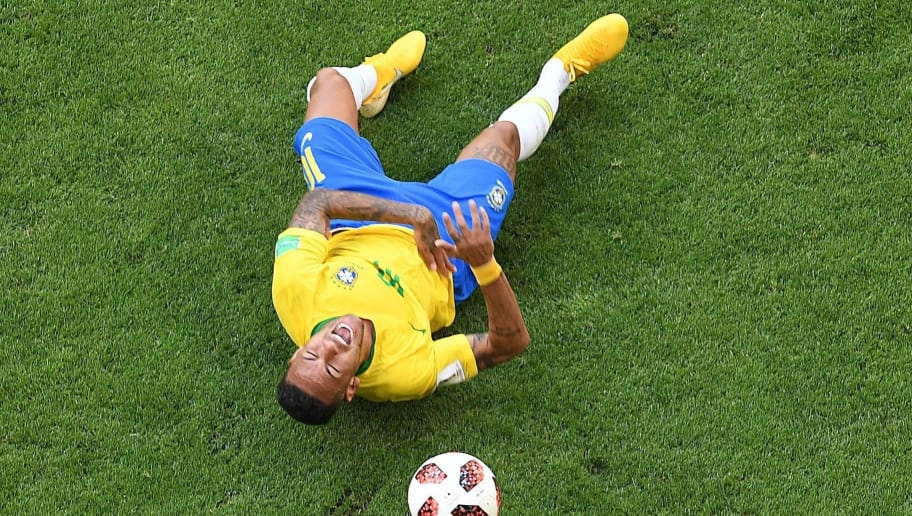 Brazil's forward Neymar reacts on the ground after being fouled during the Russia 2018 World Cup round of 16 football match between Brazil and Mexico at the Samara Arena in Samara on July 2, 2018. (Photo by Kirill KUDRYAVTSEV / AFP) / RESTRICTED TO EDITORIAL USE - NO MOBILE PUSH ALERTS/DOWNLOADS        (Photo credit should read KIRILL KUDRYAVTSEV/AFP/Getty Images)