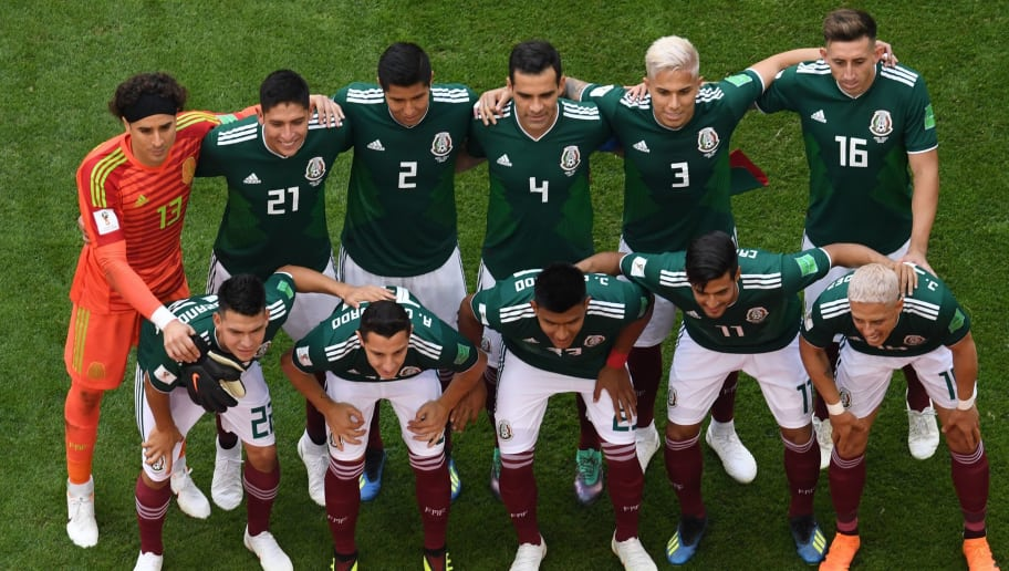 (BACK L to R) Mexico's goalkeeper Guillermo Ochoa, Mexico's defender Edson Alvarez, Mexico's defender Hugo Ayala, Mexico's midfielder Rafael Marquez, Mexico's defender Carlos Salcedo, Mexico's midfielder Hector Herrera, (FRONT L-R) Mexico's forward Hirving Lozano, Mexico's midfielder Andres Guardado, Mexico's defender Jesus Gallardo, Mexico's forward Carlos Vela and Mexico's forward Javier Hernandez pose before the Russia 2018 World Cup round of 16 football match between Brazil and Mexico at the Samara Arena in Samara on July 2, 2018. (Photo by Kirill KUDRYAVTSEV / AFP) / RESTRICTED TO EDITORIAL USE - NO MOBILE PUSH ALERTS/DOWNLOADS        (Photo credit should read KIRILL KUDRYAVTSEV/AFP/Getty Images)