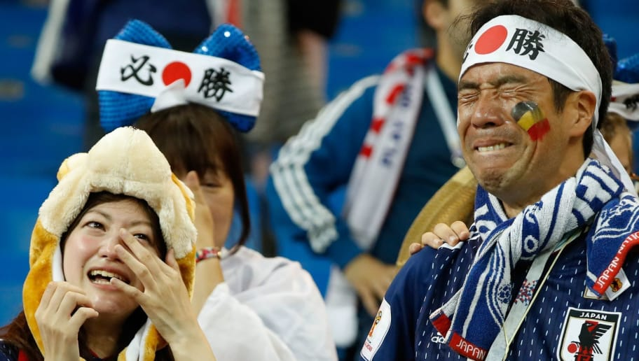 Japan's fans cry at the end of the Russia 2018 World Cup round of 16 football match between Belgium and Japan at the Rostov Arena in Rostov-On-Don on July 2, 2018. Belgium won 3-2. (Photo by Odd ANDERSEN / AFP) / RESTRICTED TO EDITORIAL USE - NO MOBILE PUSH ALERTS/DOWNLOADS        (Photo credit should read ODD ANDERSEN/AFP/Getty Images)