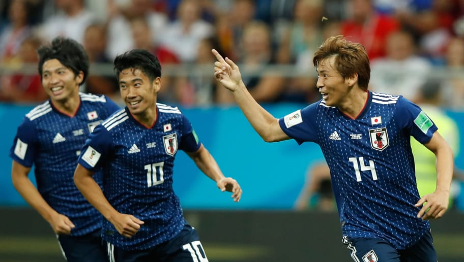 Japan's midfielder Takashi Inui (R) celebrates after scoring during the Russia 2018 World Cup round of 16 football match between Belgium and Japan at the Rostov Arena in Rostov-On-Don on July 2, 2018. (Photo by Odd ANDERSEN / AFP) / RESTRICTED TO EDITORIAL USE - NO MOBILE PUSH ALERTS/DOWNLOADS        (Photo credit should read ODD ANDERSEN/AFP/Getty Images)