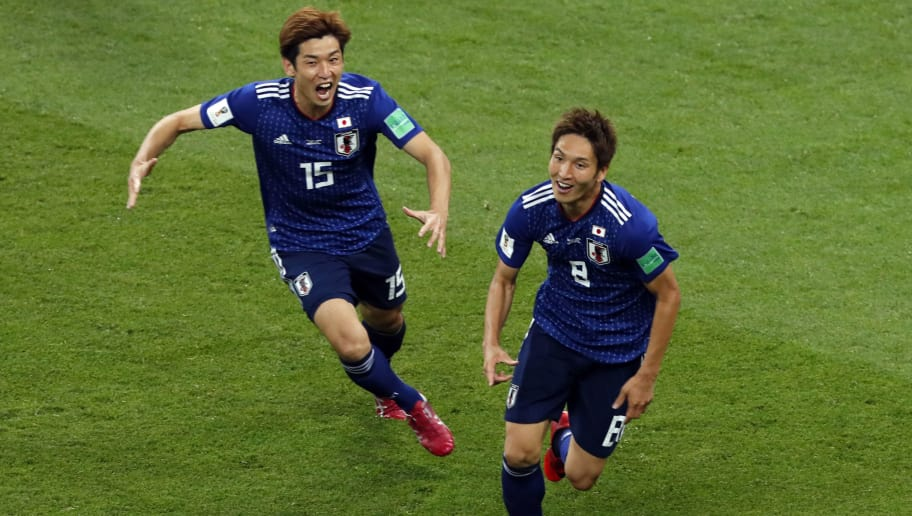 Japan's forward Genki Haraguchi (R) celebrates with Japan's forward Yuya Osako after scoring a goal during the Russia 2018 World Cup round of 16 football match between Belgium and Japan at the Rostov Arena in Rostov-On-Don on July 2, 2018. (Photo by Jack GUEZ / AFP) / RESTRICTED TO EDITORIAL USE - NO MOBILE PUSH ALERTS/DOWNLOADS        (Photo credit should read JACK GUEZ/AFP/Getty Images)