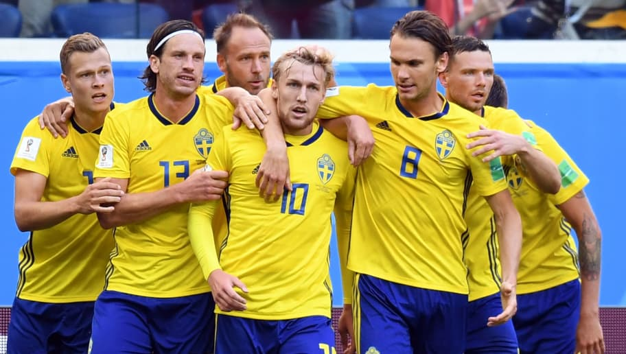 Sweden's midfielder Emil Forsberg (C) celebrates with teammates (fromL) Sweden's forward John Guidetti, Sweden's midfielder Gustav Svensson and Sweden's midfielder Albin Ekdal after scoring the opener during the Russia 2018 World Cup round of 16 football match between Sweden and Switzerland at the Saint Petersburg Stadium in Saint Petersburg on July 3, 2018. (Photo by Paul ELLIS / AFP) / RESTRICTED TO EDITORIAL USE - NO MOBILE PUSH ALERTS/DOWNLOADS        (Photo credit should read PAUL ELLIS/AFP/Getty Images)
