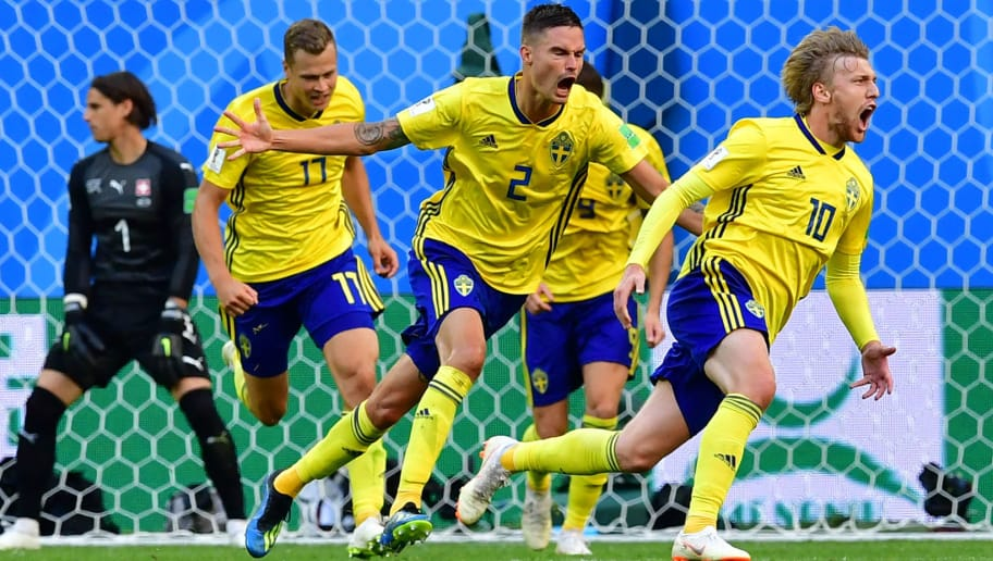Sweden's midfielder Emil Forsberg (R) celebrates scoring during the Russia 2018 World Cup round of 16 football match between Sweden and Switzerland at the Saint Petersburg Stadium in Saint Petersburg on July 3, 2018. (Photo by Giuseppe CACACE / AFP) / RESTRICTED TO EDITORIAL USE - NO MOBILE PUSH ALERTS/DOWNLOADS        (Photo credit should read GIUSEPPE CACACE/AFP/Getty Images)